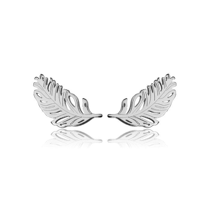 Srebrne kolczyki pióro anioła