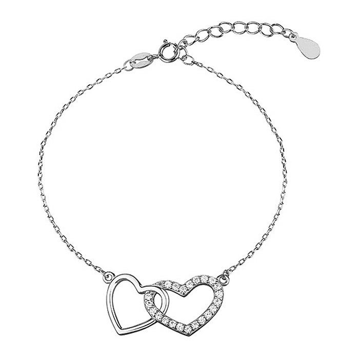 Srebrna bransoletka podwójne serce z cyrkoniami